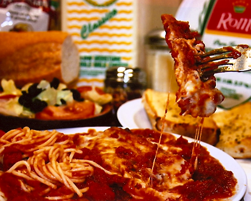 Chicken Parmigiana Dinner with a side of spaghetti and garlic bread